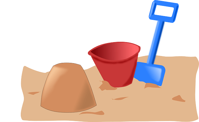 A sandbox with a shovel and bucket.